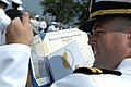 US Navy 080627-N-8148A-233 Lt. Thomas Thomas, from Norfolk, Va., tries to locate himself in a graduating class picture after the conclusion of Naval Medical Center Portsmouth intern class of 2008 graduation ceremony.jpg