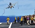US Navy 081006-N-7981E-278 Tiger Cruise participants aboard the aircraft carrier USS Abraham Lincoln (CVN 72) watch from behind the flight deck foul lines as an F-A-18C Hornet assigned to.jpg