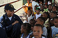 US Navy 081112-N-9774H-162 Operations Specialist 3rd Class Danielle Evans, embarked aboard the amphibious assault ship USS Kearsarge (LHD 3), interacts with children at the East Ruimveldt Community Center.jpg