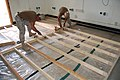 US Navy 090317-N-1057H-105 Seabees assigned to Naval Mobile Construction Battalion (NMCB) 11 Detachment. Horn of Africa install a new floor.jpg