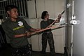 US Navy 090418-N-7286M-024 Philippine Army Pfc. Joel Manzano and U.S. Navy Religious Program Specialist 1st Class Jennifer Herman paint the health clinic at St. Clare Patronage during a community service project.jpg