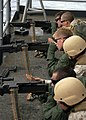 US Navy 090522-N-6720T-049 Marines assigned to Fleet Anti-Terrorism Security Team Pacific (FASTPAC) instruct sailors during an M-240B machine gun live-fire exercise aboard the aircraft carrier USS George Washington (CVN-73).jpg