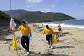 US Navy 091020-N-8335D-101 Sailors assigned to the mine countermeasures ship USS Defender (MCM 2) clean Nagata Maehama beach on the Japanese island of Yakushima.jpg
