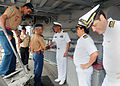 US Navy 100423-N-9301W-088 Cmdr. Scott Smith, commanding officer of the guided-missile frigate USS Klakring (FFG 42), welcomes Brazilian military and port authorities in Fortaleza, Brazil to a luncheon aboard the ship.jpg