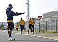US Navy 101112-N-7103C-094 Personnel Specialist Seaman Kendall Kershaw times the mile and a half run portion of the Navy Physical Readiness Test at.jpg