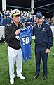 US Navy 111001-N-FC670-081 Chief of Naval Operations (CNO) Adm. Jonathan Greenert, left, is presented with an Air Force jersey by Gen. Norton A. Sc.jpg