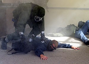 "Joint Terrorism Task Force - Naval Station Anacostia, Washington, D.C. (Sept. 13, 1999) -- Members of the U.S. Park Police (USPP) ""SWAT"" team take down ""terrorists"" who were holding hostages at Naval Support Facility Anacostia. The anti-terrorist exercise pitted police against the chemical biological warfare terrorists. Taking part in the day-long exercise were the FBI Joint Terrorism Task Force, the Naval district Washington Police, Naval District Washington Fire and Hazmat, the U.S. Capitol Police (USCP), U.S. Army Technical Escort Unit (TEU), and the Washington Metropolitan Fire and Hazmat unit."