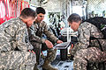 US and ROKA Soldiers perform cold load operations 042115-A-AB123-001.jpg