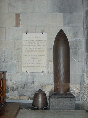 APCBC - Unexploded British naval 15-inch shell in Genoa Cathedral, fired in 1941, with its armor-piercing cap on the floor to the left. The ballistic cap is absent.