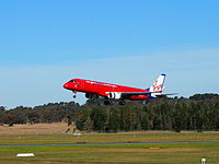 A Virgin Australia Embraer ERJ-190 shortly before landing at Canberra Airport