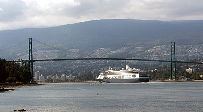 A cruise ship passing under Lions Gate Bridge