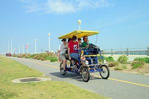 Culture in Virginia Beach - People enjoying rental bicycle on the Boardwalk
