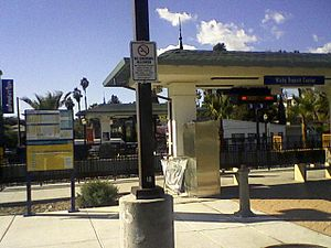 North County Transit District - No smoking sign at the Vista Transit Center. Notice the butt receptacle placed about 10 feet behind the sign next to the ticket vending machines.