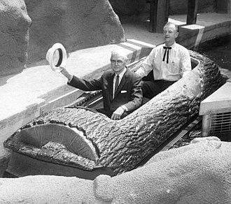 Log flume (ride) - Walter Knott and Bud Hurlbut ride the Timber Mountain Log Ride at Knott's Berry Farm in 1969