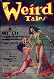Two identical women on a paved floor that fades to shadow in the background. One woman stands, smiling, holding a cat'o'nine-tails whip in her left hand and the other woman's wrist in her right. The second woman kneels helplessly on the floor.