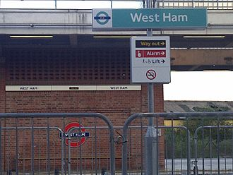 West Ham station - West Ham Station Signs with the new DLR sign in the foreground and Jubilee line sign in the background.
