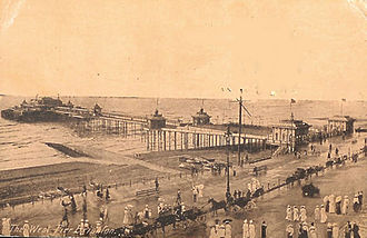 West Pier - West Pier circa 1900. By this time a central bandstand and full-length weather screens had been added. A pavilion had opened in 1893.
