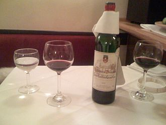 Glossary of wine terms - Wine bottle with drip cloth around it
