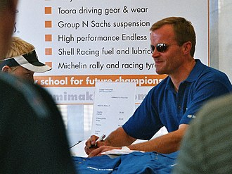 Tommi Mäkinen - A retired Mäkinen signing autographs during a visit to Rally Finland in 2004.