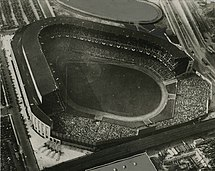 Black and white aerial view of Old Yankee Stadium, looking towards home plate from the outfield.