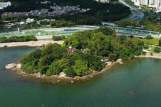 Tai Po New Town - former island Yuen Chau Tsai. Island House is located on the island. Park on the right was Yuen Chau Tsai Park