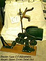 "Zander Type C-7 Adjustable Weight Upper Torso Twist Unit"" is a U-shaped velvet seat atop an enamel iron base with a leather (f824dafc-165a-44ce-8dad-e915f77e507f).JPG"