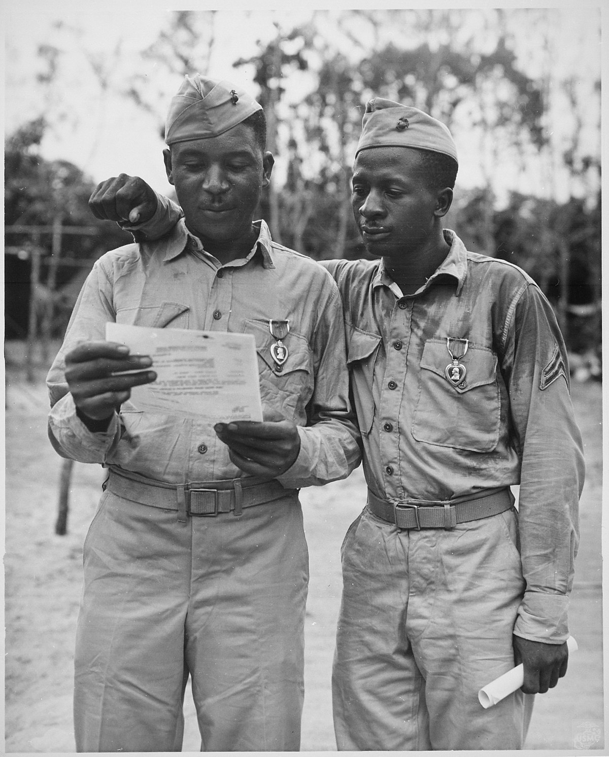 """File:""""First Negro Marines decorated by the famed Second Marine Division somewhere in the Pacific (left to right) Staff Sgt Ti - NARA - 535872.jpg - Wikimedia Commons"""