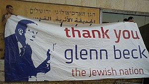 Glenn Beck - Israeli citizens holding banner at the Jerusalem Restoring Courage rally, in which Beck was the main speaker