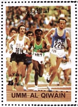 Frank Shorter - Shorter (left) running 10,000 m at the 1972 Olympics, stamp of Umm al-Quwain