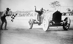 Riding mechanic - Joe Dawson (left) and riding mechanic Harry Martin (visible on the right of the cockpit) winning the 1912 Indianapolis 500.