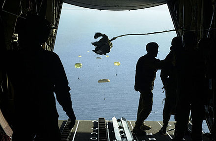 Soldiers from the 1st Commando Company parachute with their inflatable boats from an RAAF C-130H into Shoalwater Bay 1st Commando Company.jpg