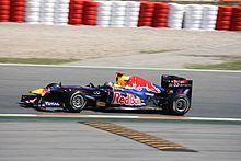 Photographie de Sebastian Vettel dans sa monoplace lors des essais libres