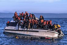 20151030 Syrians and Iraq refugees arrive at Skala Sykamias Lesvos Greece 1.jpg