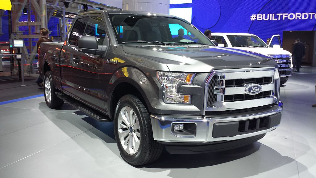english view of the unique headlights and front bumper of the new 2015 ford f 150 at the. Black Bedroom Furniture Sets. Home Design Ideas