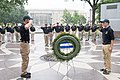 2015 Law Enforcement Explorers Conference saluting a wreath at the memorial.jpg
