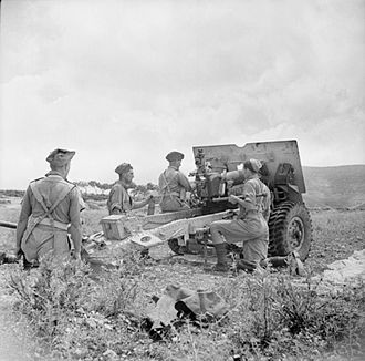 Leicestershire Yeomanry - A 25-pdr field gun of 153rd Field Regiment during a practice shoot in June 1943.