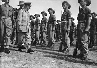 2/9th Commando Squadron (Australia) - 2/9th Commando Squadron being inspected by GOC 6th Division, Aitape, New Guinea, 17 April 1945.