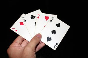 """A meld of four cards in the game Shangha..."