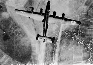 44th Fighter Group - B-24 of the 44th Bomb Group hit by enemy fire on a mission over enemy territory.