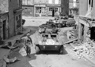 82nd Armored Reconnaissance Battalion - 82nd Armored Reconnaissance Battalion in an M8.
