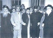 משה פרוש (מימין) לצדם של רבני ישיבת פורת יוסף