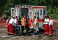 ADAC MX Masters abtransport eines verletzten Fahrers mit Krankenwagen von Malteser Hilfsdienst.JPG