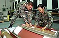 AIRMAN First Class (A1C) John Carney and A1C Ana Abreu, from the 31st Munitions Squadron Camp Darby, Italy, visual inspects a WGU-12. 31st Munitions Squadron is a 129-person, Geogra - DPLA - 5dad7fec71ea4259a62830d379ad5224.jpeg