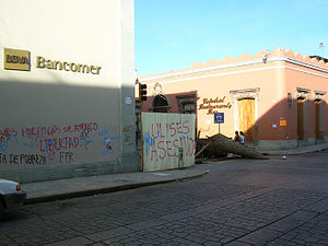 2006 Oaxaca protests - APPO barricade and graffiti in central Oaxaca, June 2006.