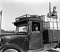 """A """"HAGANA"""" GUARD ACCOMPANYING A TRUCK CARRYING ORANGES. שומר של ארגון ההגנה מלווה משאית הנושאת ארגזי תפוזים.D393-021.jpg"""
