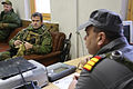 A Norwegian soldier discusses training operations with a Ukrainian soldier, right, playing the role of an Afghan National Police chief during a military adviser team (MAT) and police adviser team (PAT) training 131210-A-RJ750-005.jpg