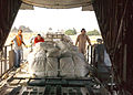A Sailor helps to load pallets bound for Pakistan DVIDS11541.jpg
