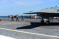 A U.S. Sailor, center, directs a Navy X-47B Unmanned Combat Air System demonstrator aircraft aboard the aircraft carrier USS George H.W. Bush (CVN 77) May 14, 2013, in the Atlantic Ocean 130514-N-TB177-393.jpg