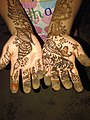 A baby girl wearing Henna(Mehndi) on the occasion of Eid.jpg