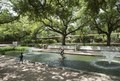 A boy enjoys a lovely pond and fountain away from the animals at the Houston, Texas, zoo LCCN2014633251.tif